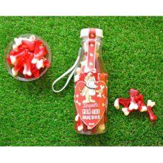 botella personalizada rellena de chuches huesitos gominolas